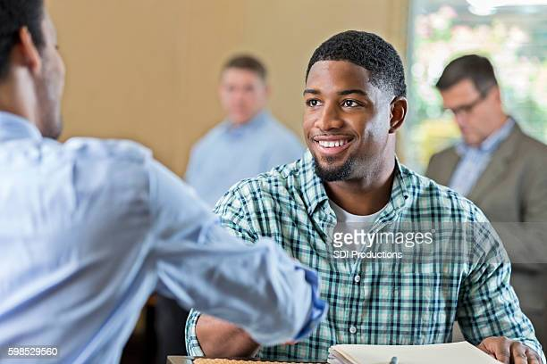 Handsome young African American man at job interview