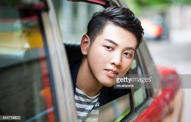 Handsome Young Asian Using Taxi Service in China
