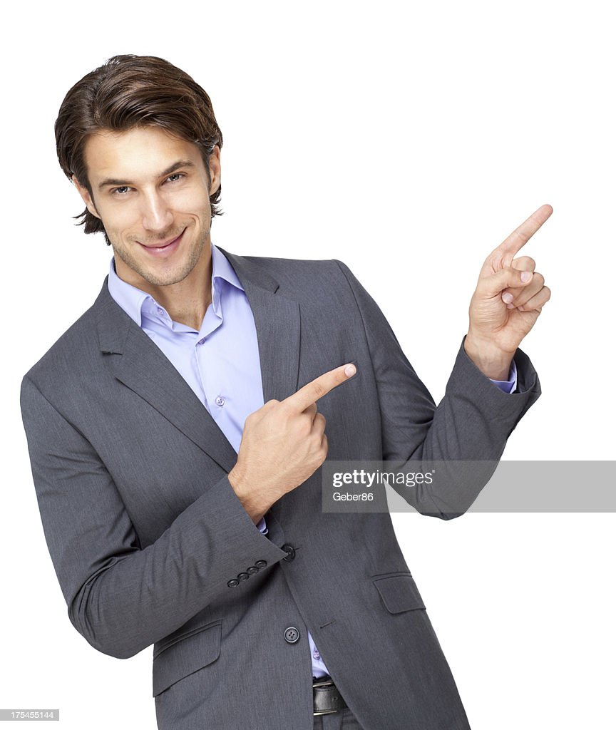 handsome young businessman pointing at copy-space