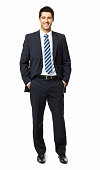 Young businessman standing confidently with his hands in his pockets. Vertical shot. Isolated on white.