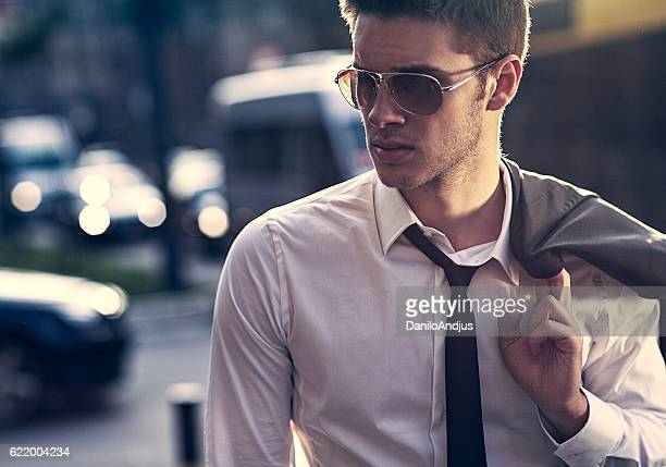 handsome young businessman walking on the way home