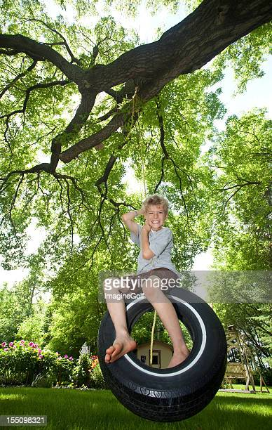 Handsome Young Caucasian Boy on a Tire Swing