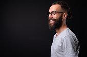 Studio Shot Of Handsome Young Man Against Black Background
