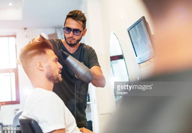 Handsome young man at hairdresser