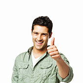 Handsome Young Man Giving the Thumbs Up - Isolated
