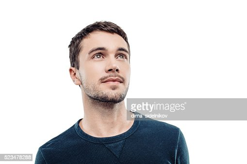 Bonito jovem sobre fundo branco : Foto de stock