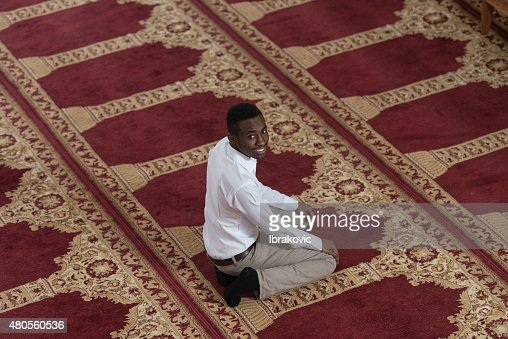 Handsome Young Man Smiling In The Mosque : Stock Photo