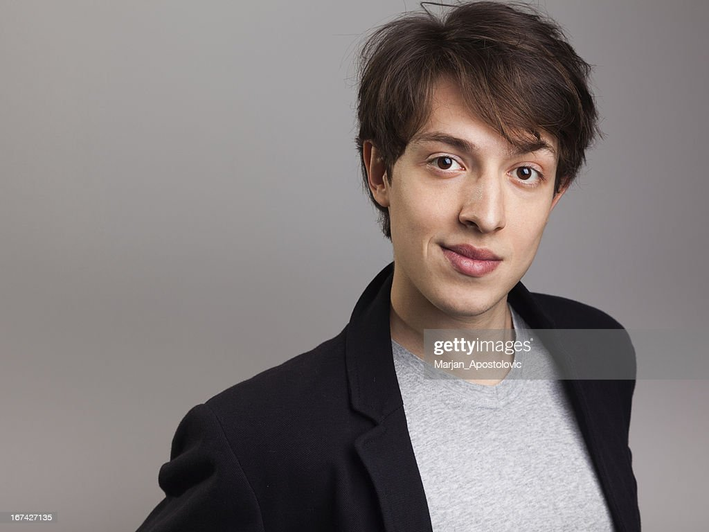 Handsome young man smiling : Stock Photo