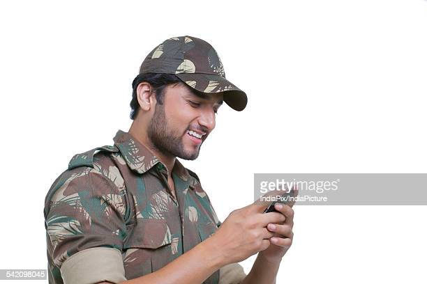 Handsome young man texting on cell phone