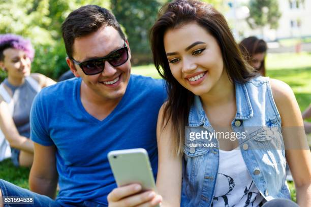 Handsome young man using smartphone outdoor