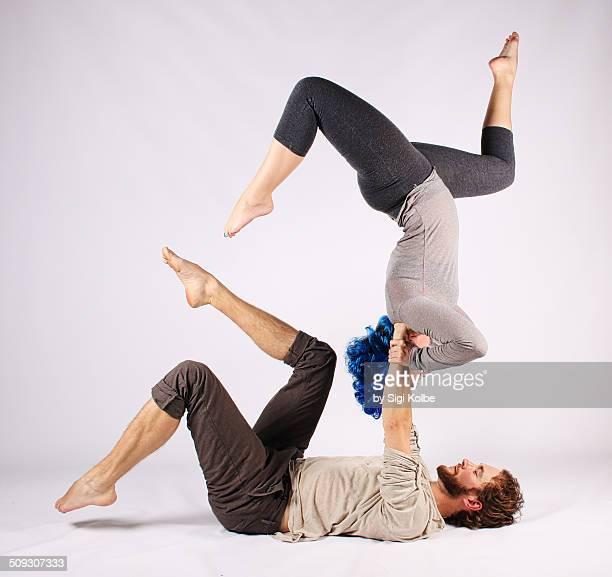 Handstand acro yoga