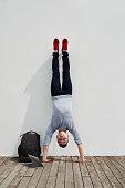 Vietnamese sporty man performing handstand