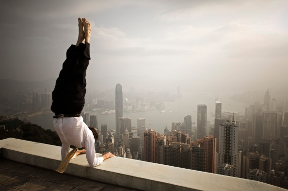 A handstand yoga pose on the rooftop MODEL RELEASED
