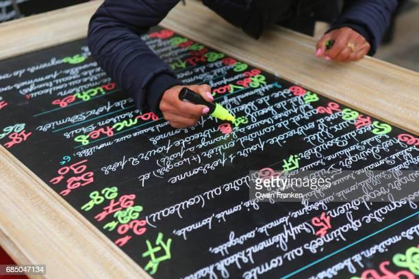 handwriting a menu in a bistro