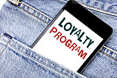 Handwriting Announcement text showing Loyalty Program. Business concept for Marketing Concept Written phone mobile phone, cellphone placed in man front jeans pocket.