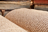 Opened vintage book in a library. 400 year old handwrite. Photo was taken at avaible light, and it is slightly toned to enhance the old condition of the books.