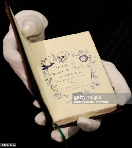 A handwritten copy of 'The Tales of Beedle the Bard' by JK Rowling on show at Sotheby's in London today The previously untold stories will be...