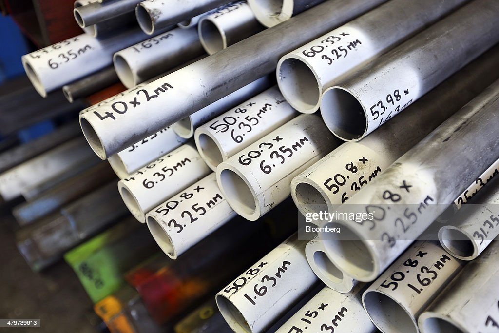 Handwritten dimensions sit on the ends of steel pipes stored in the warehouse at Metal Supermarkets in Southampton, U.K., on Friday, Nov. 15, 2013. The Bank of England sees gross domestic product rising 0.9 percent this quarter before easing in the early part of 2014, according to its new projections. Photographer: Chris Ratcliffe/Bloomberg via Getty Images