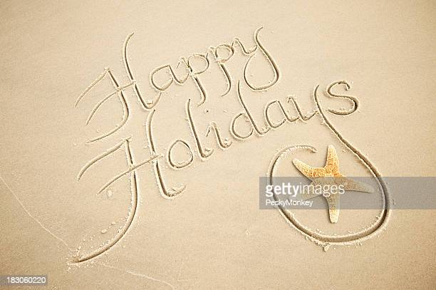 Handwritten Happy Holidays Greeting Message with Decorative Starfish in Sand