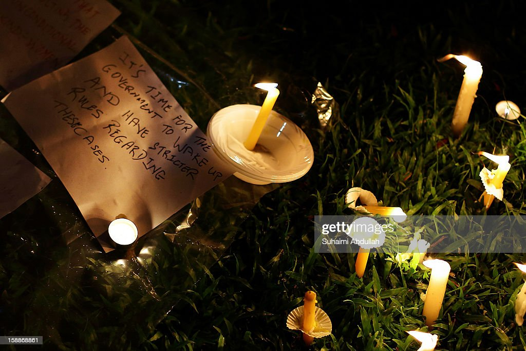 Handwritten notes and candles are seen during candlelight vigil in honor of the memory of the gang rape victim, a 23-year-old medical student, at Hong Lim Park on January 2, 2013 in Singapore. The victim of a gang rape and murder which triggered an outpouring of grief and anger across India died on December 29, 2012 after she was flown in to Singapore for treatment following her severe injuries.