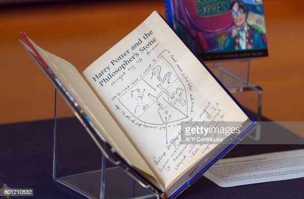 Handwritten notes by author JK Rowling are pictured inside a rare first edition of her book 'Harry Potter and the Philosopher's Stone'm displayed at...