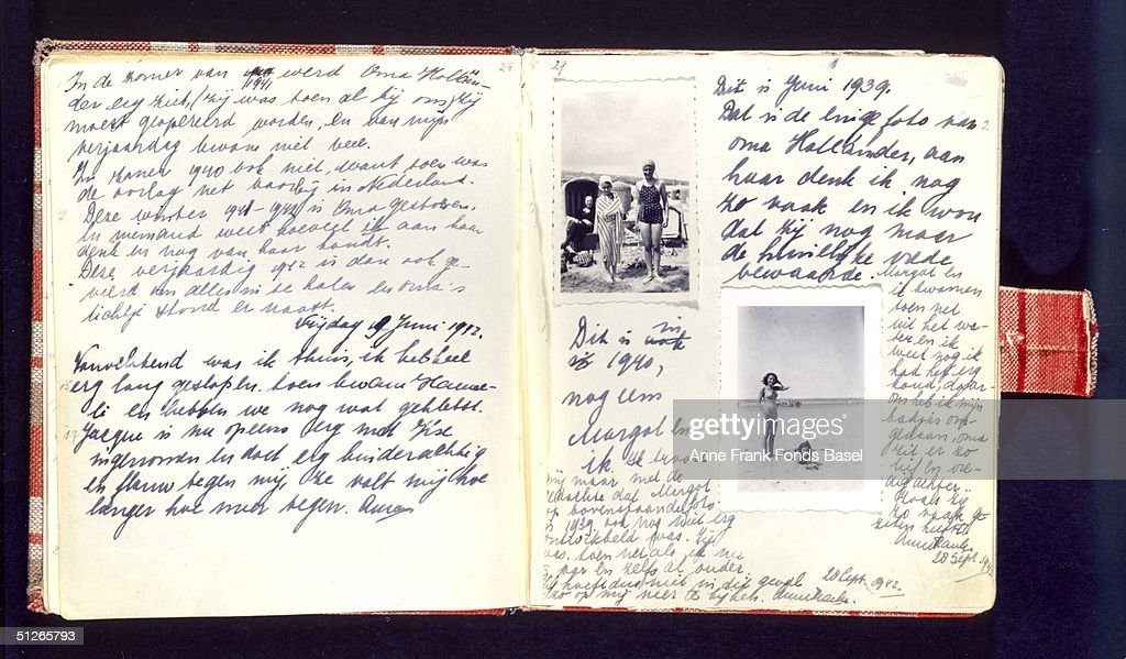 A handwritten page of <a gi-track='captionPersonalityLinkClicked' href=/galleries/search?phrase=Anne+Frank&family=editorial&specificpeople=173492 ng-click='$event.stopPropagation()'>Anne Frank</a>'s diary which she kept during her wartime confinement, it includes photographs of her on the beach during a holiday with sister Margot.