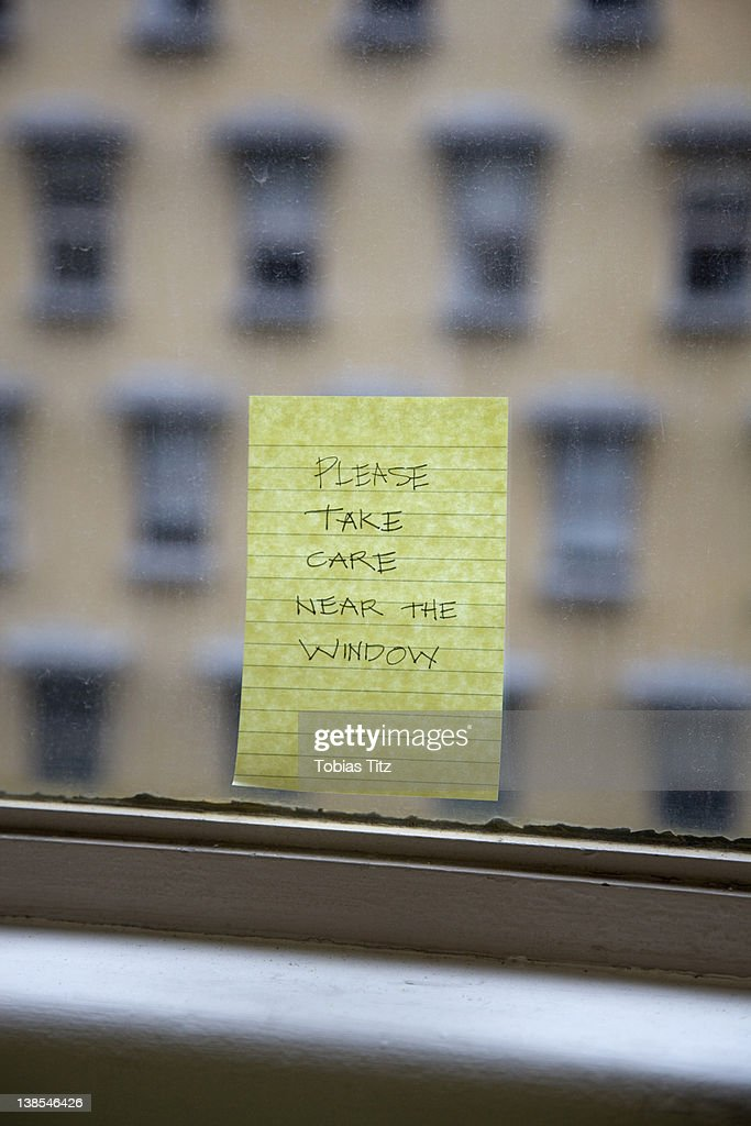 Handwritten sticky note reminding to Please Take Care Near The Window