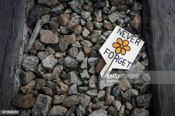 A handwritten wooden sign 'Never forget' left during 'March of the Living' at the former NaziGerman Auschwitz Birkenau concentration and...
