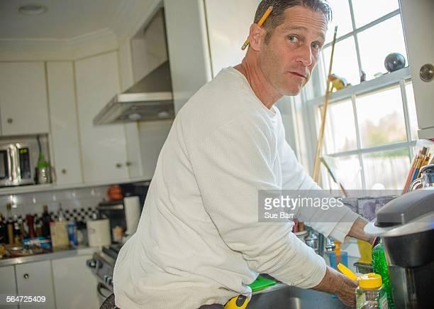 Handyman using kitchen sink