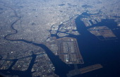 Haneda Airport center is seen in this aerial photograph taken through an airplane window in Tokyo Japan on Monday Jan 6 2014 Japan's currentaccount...