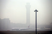 Haneda International Airport is covered with dense fog on March 8 2016 in Tokyo Japan 34 flights from the airport were cancelled