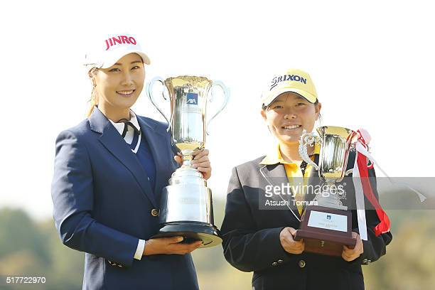 HaNeul Kim of South Korea and Minami Katsu of Japan pose with the trophy after winnig the AXA Ladies Golf Tournament at the UMK Country Club on March...