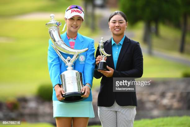 HaNeul Kim of South Korea and Yuka Saso of Philippines poses with the trophy after winning the Suntory Ladies Open at the Rokko Kokusai Golf Club on...