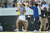 HaNeul Kim of South Korea is doused with water by JaeEun Chung and HeeKyung Bae of South Korea after winning the Munsingwear Ladies Tokai Classic at...