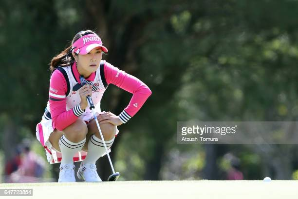 HaNeul Kim of South Korea lines up her putt on the 4th hole during the third round of the Daikin Orchid Ladies Golf Tournament at the Ryukyu Golf...
