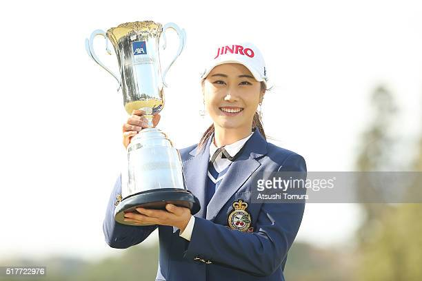 HaNeul Kim of South Korea pose with the trophy after winnig the AXA Ladies Golf Tournament at the UMK Country Club on March 27 2016 in Miyazaki Japan
