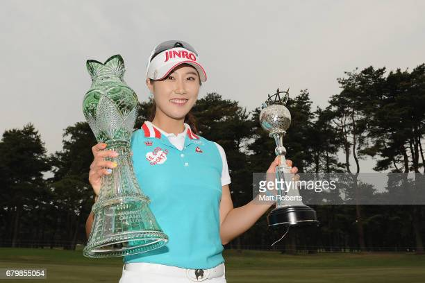 HaNeul Kim of South Korea poses for a photo holding the winners trophy on the 18th green during the final round of the World Ladies Championship...