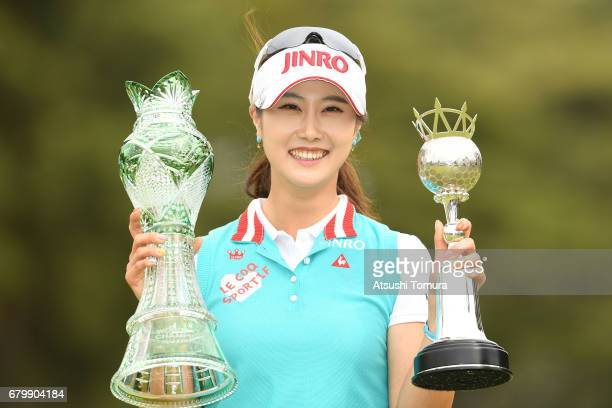 HaNeul Kim of South Korea poses with the trophies after winning the World Ladies Championship Salonpas Cup at the Ibaraki Golf Club on May 7 2017 in...