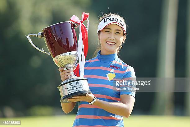 HaNeul Kim of South Korea poses with the trophy after winning the Munsingwear Ladies Tokai Classic at the Shin Minami Aichi Country Club Mihama...