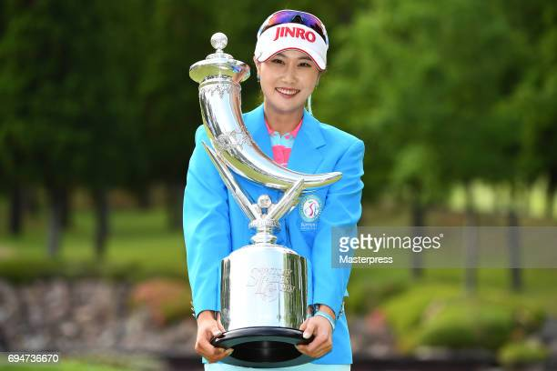 HaNeul Kim of South Korea poses with the trophy after winning the Suntory Ladies Open at the Rokko Kokusai Golf Club on June 11 2017 in Kobe Japan