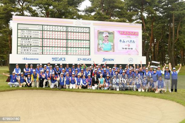 HaNeul Kim of South Korea poses with tournament volunteers after winning the World Ladies Championship Salonpas Cup at the Ibaraki Golf Club on May 7...