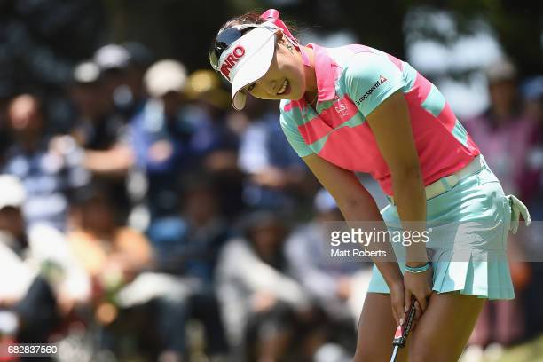 HaNeul Kim of South Korea reacts after her putt on the 14th green during the final round of the HokennoMadoguchi Ladies at the Fukuoka Country Club...