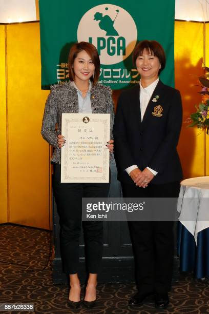 HaNeul Kim of South Korea receives a certificate from LPGA Hiromi Kobayashi during the Ladies Professional Golfers' Association of Japan induction...