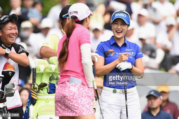 HaNeul Kim of South Korea shares a laugh with Erika Kikuchi of Japan before her tee shot on the 1st hole during the final round of the Nipponham...
