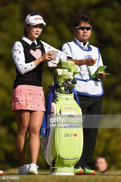 HaNeul Kim of South Korea shares a laugh with her caddie during the second round of the Itoen Ladies Golf Tournament 2017 at the Great Island Club on...