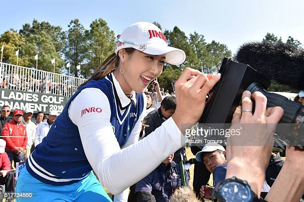 HaNeul Kim of South Korea signs an autograph on the TV camera after winning the AXA Ladies Golf Tournament at the UMK Country Club on March 27 2016...