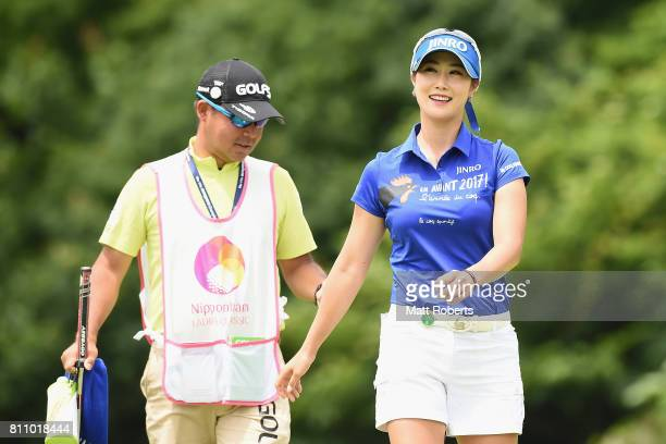 HaNeul Kim of South Korea smiles after her putt on the 12th green during the final round of the Nipponham Ladies Classics at the Ambix Hakodate Club...