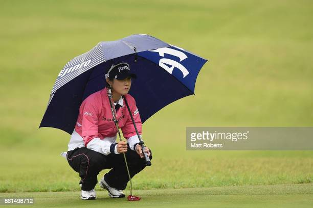 HaNeul Kim of South Korea waits to putt on the 4th green during the final round of the Fujitsu Ladies 2017 at the Tokyu Seven Hundred Club on October...