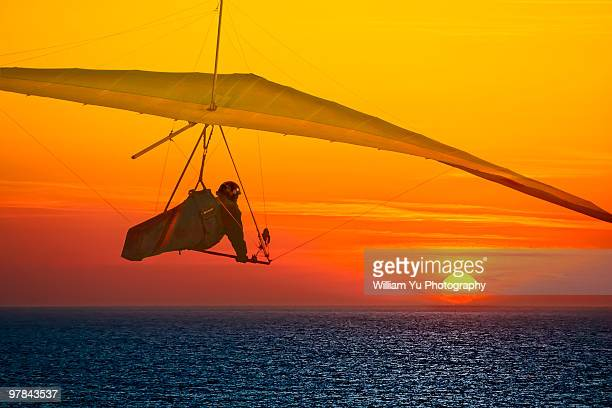 A Hang Glider flying at sunset
