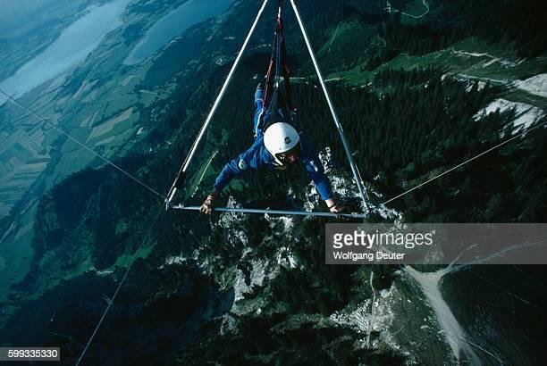 Hang Gliding Above Mountainous Landscape